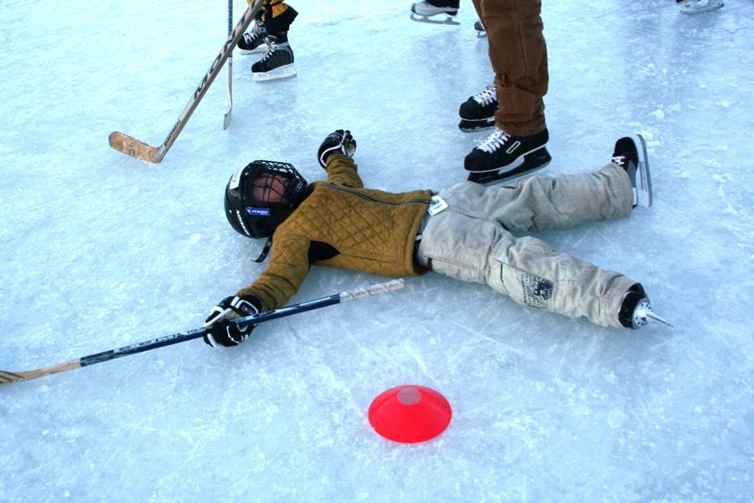 kid on the ice rink