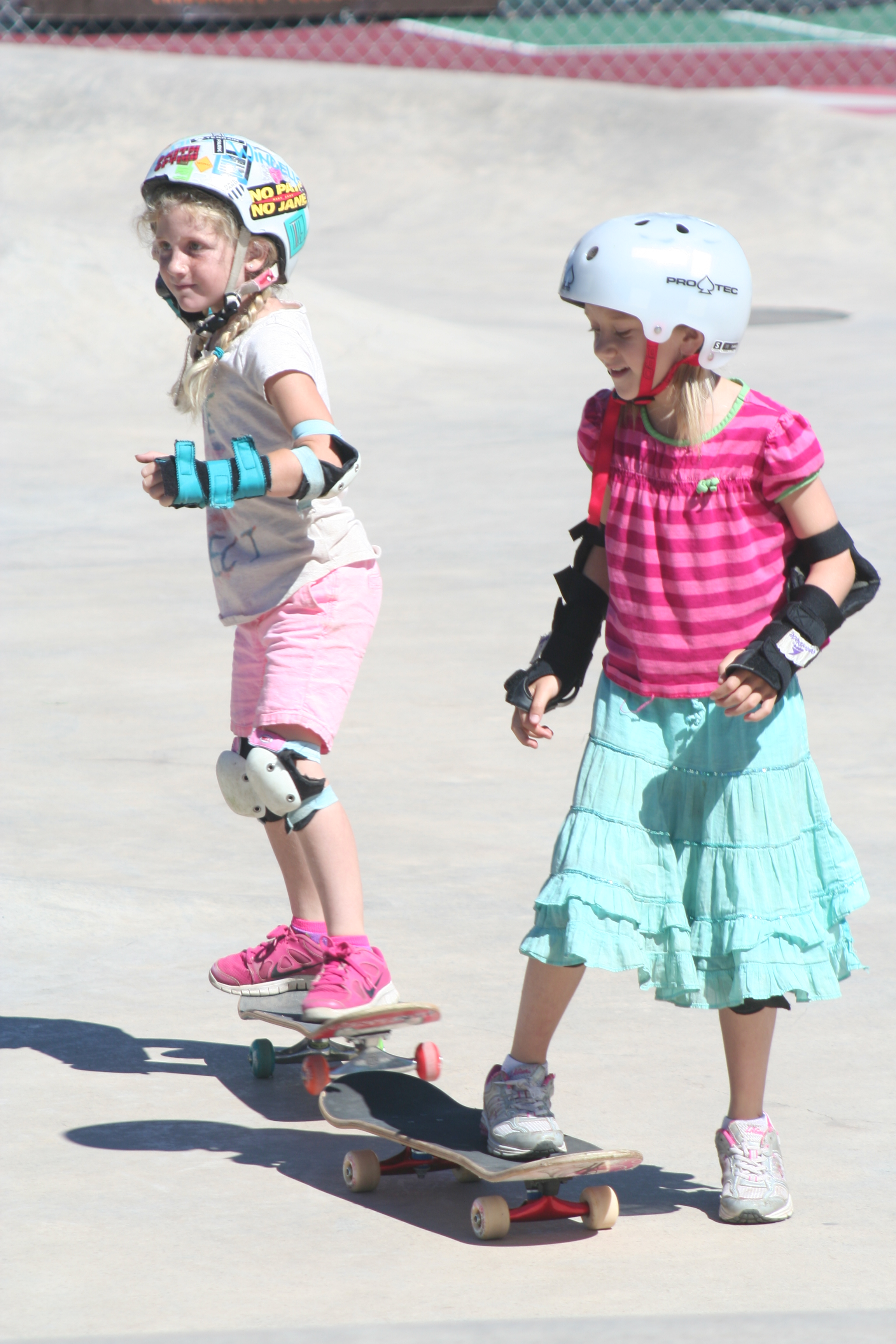 two girls on skateboards